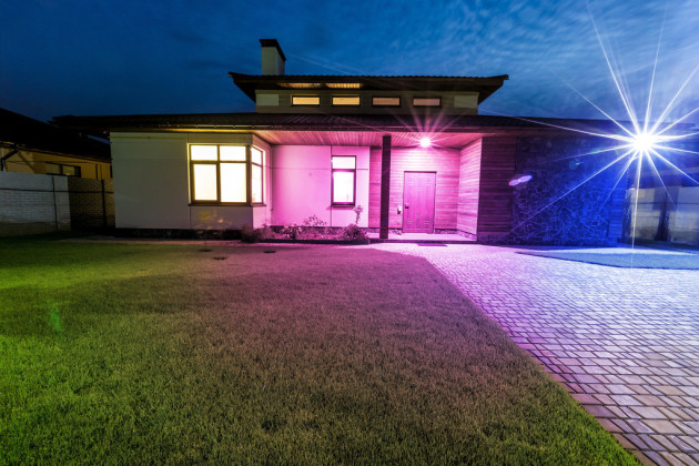 Detached luxury house at night view from outside front entrance.